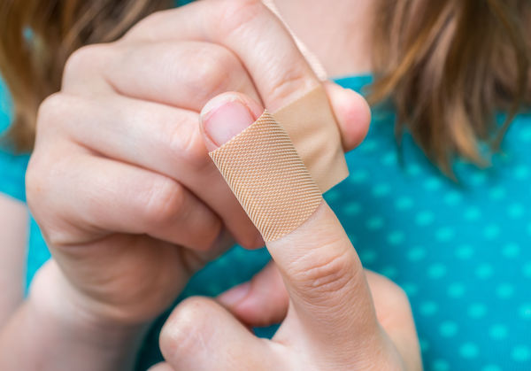 child with bandaged finger